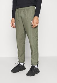 Nike Sportswear - Tracksuit bottoms - twilight marsh/white - 0