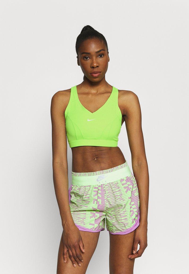 Nike Performance - BRA  - Medium support sports bra - lime glow/barely green