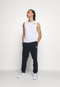 adidas Performance - CUT - Tracksuit bottoms - legink/white - 1
