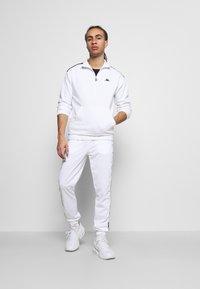 Kappa - INGVALDO - Pantalon de survêtement - bright white - 1