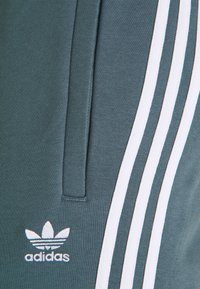 adidas Originals - 3 STRIPES PANT - Tracksuit bottoms - bluoxi - 2
