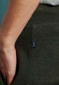 Superdry - ORANGE LABEL - Tracksuit bottoms - winter khaki grit - 2