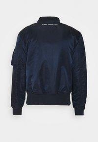 Alpha Industries - Light jacket - blue - 2