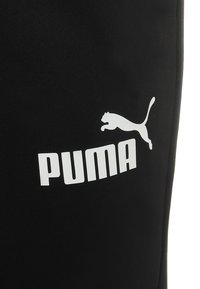 Puma - LOGO PANTS - Tracksuit bottoms - black - 2