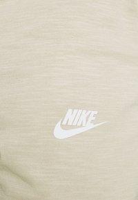 Nike Sportswear - Pantalones deportivos - grain/coconut milk/ice silver/white - 5
