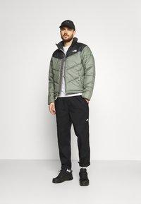 The North Face - SAIKURU JACKET - Winter jacket - olive - 1