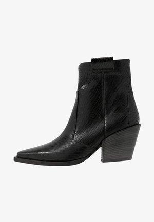 TONI - Ankle boots - schwarz