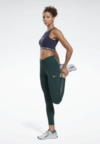Reebok - LES MILLS® LUX PERFORM LEGGINGS - Collant - green - 1