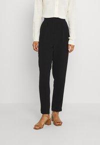 Vila - VIRASHA  - Trousers - black - 0