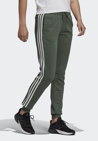 adidas Performance - ESSENTIALS FRENCH TERRY STRIPES PANTS - Tracksuit bottoms - greoxi/white - 0