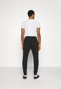 Hollister Co. - ICONIC PRINT JOGGER - Tracksuit bottoms - black stack gull - 2