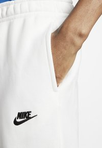 Nike Sportswear - CLUB - Tracksuit bottoms - white/white/black - 4