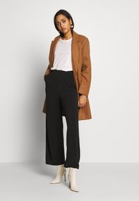 ONLY - ONQGAIA WIDE PANT - Trousers - black - 1