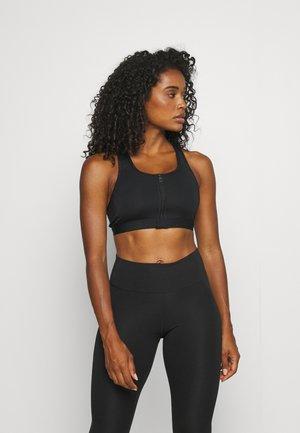 ZIP FRONT BRA - Medium support sports bra - black/white