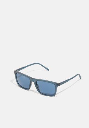 Zonnebril - matte transparent blue
