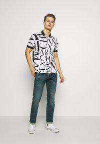 Armani Exchange - Koszulka polo - white/black - 1