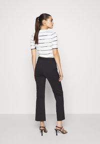 DESIGNERS REMIX - SANSAH FLARED - Trousers - black - 2