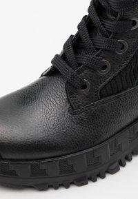 Versace - LOGATA - Lace-up ankle boots - black - 5
