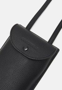 Coccinelle - PORTA TELEPHONO - Across body bag - noir - 4