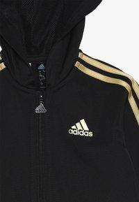 adidas Performance - SHINY  - Tracksuit - black/gold - 6