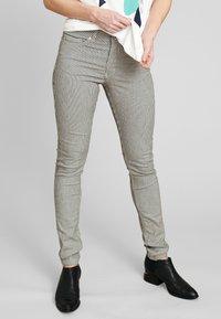 ECHTE - Trousers - black - 0
