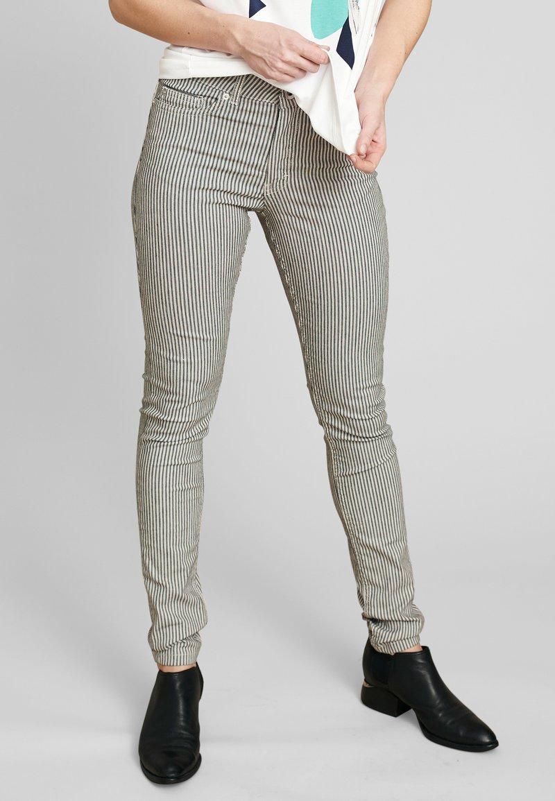 ECHTE - Trousers - black