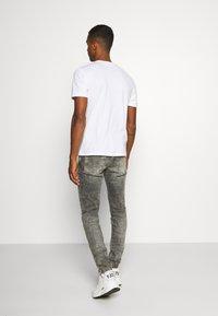 Diesel - D-STRUKT - Jeans fuselé - grey - 2