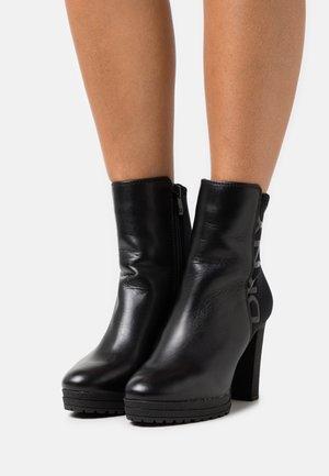TESSI PLATFORM BOOTIE  - Bottines à plateau - black/shiny black