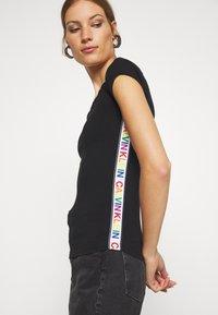 Calvin Klein - BARDOT PRIDE - Print T-shirt - black - 3