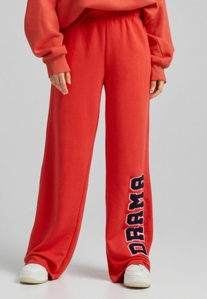 STRAIGHT FIT  - Tracksuit bottoms - red