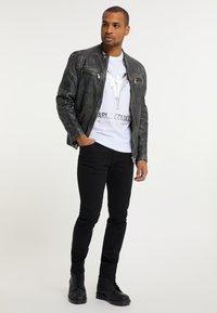Carlo Colucci - Leather jacket - grey - 1