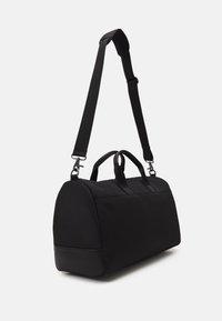 Calvin Klein - UNISEX - Weekend bag - black - 1