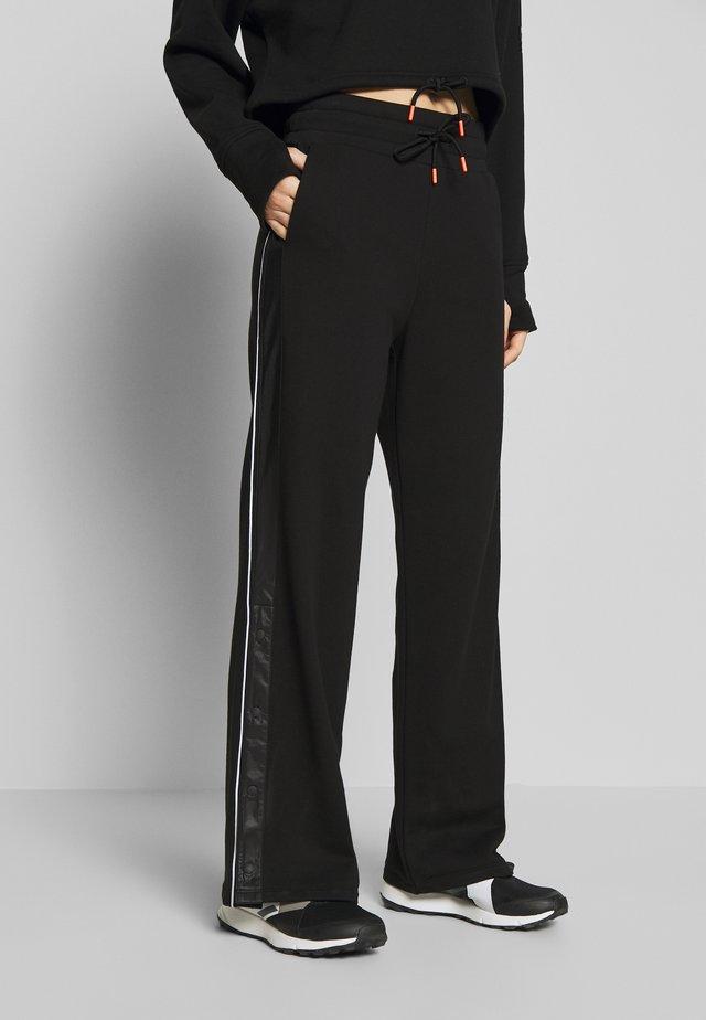 ROBIN - Spodnie treningowe - black