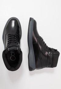 Calvin Klein - PHYFELACE UP BOOTIE - Nauhalliset nilkkurit - black - 1