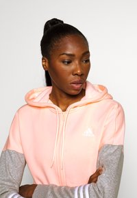 adidas Performance - ENERGIZE SPORTS SLIM TRACKSUIT - Trainingsanzug - coral