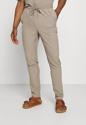CRINKLE TAPERED JOGGER - Trousers - cream