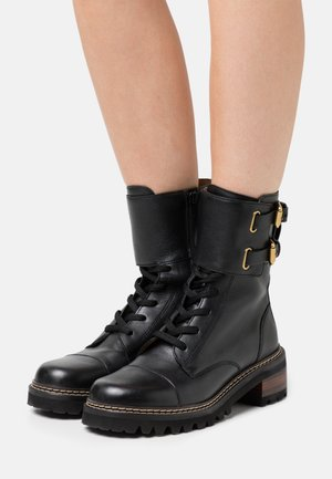 Platform ankle boots - texan nero