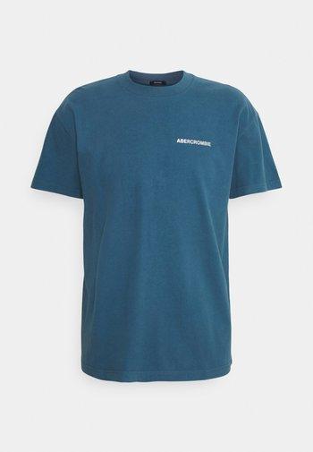 CIRCLE FOIL GRAPHIC - T-shirt med print - light blue