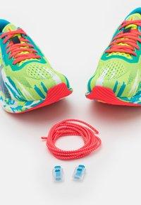 ASICS - NOOSA TRI 13 - Competition running shoes - hazard green/digital aqua - 5