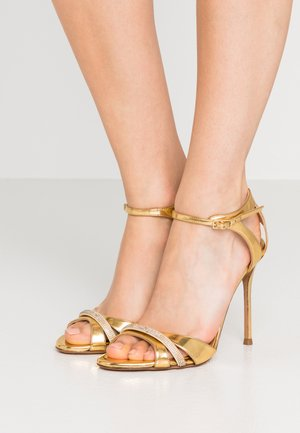 High heeled sandals - mirror gold