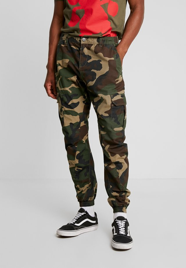 PANTS - Cargo trousers - wood