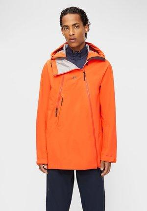 BRETT SHELL - Waterproof jacket - juicy orange
