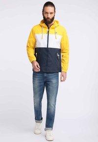 Schmuddelwedda - Waterproof jacket - yellow - 1