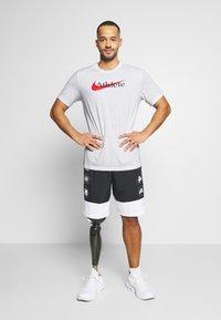 Nike Performance - TEE ATHLETE - Camiseta estampada - white/university red - 1