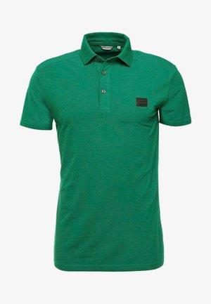 SPORT PLAQUETTE - Polo - verde