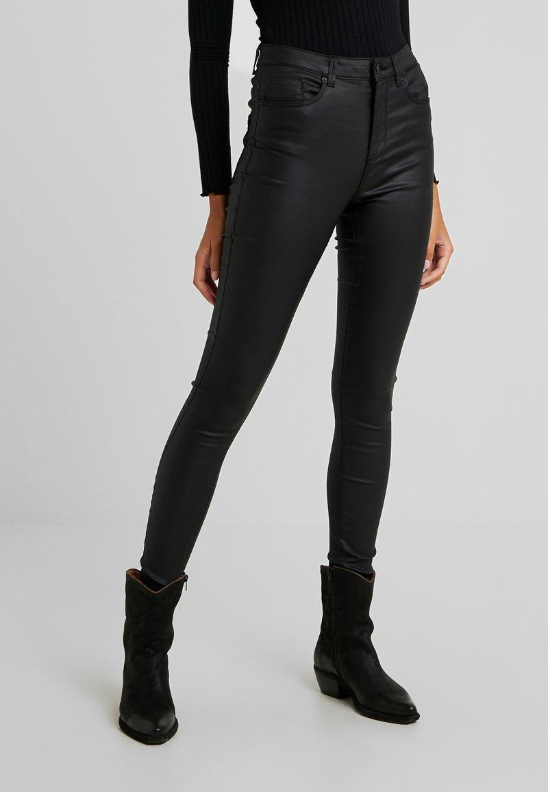 Vero Moda - VMSOPHIA COATED PANTS - Trousers - black