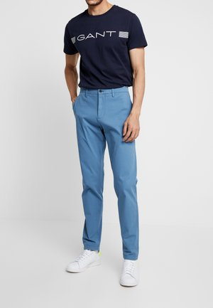 SMART FLEX TAPERED - Trousers - copen blue