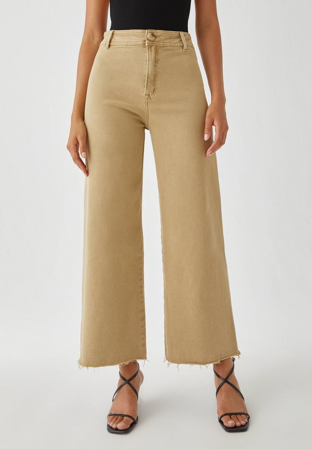Flared Jeans - camel