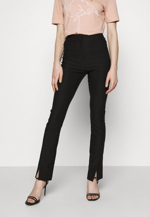 ELEA TROUSERS - Tygbyxor - black