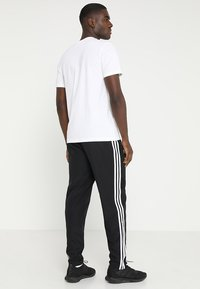 adidas Performance - TIRO 19 - Pantalon de survêtement - black - 2